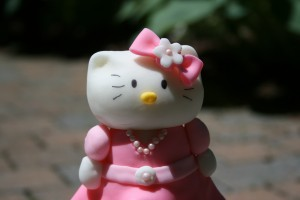 Kitty with a sugar pearl necklace.